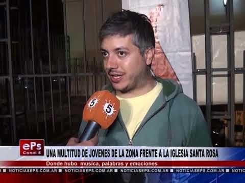 UNA MULTITUD DE JOVENES DE LA ZONA FRENTE A LA IGLESIA SANTA ROSA